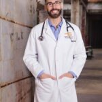 A Gay Male Physician Standing